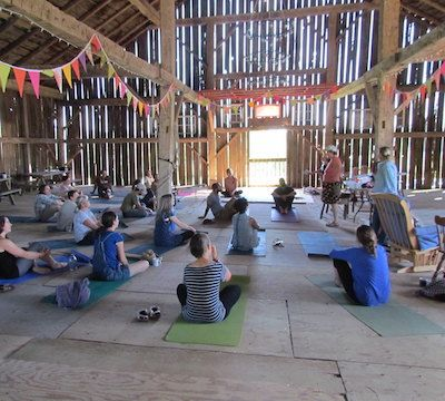 Farmers doing yoga in the barn