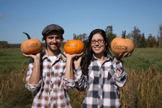 farmers holding pumpkins