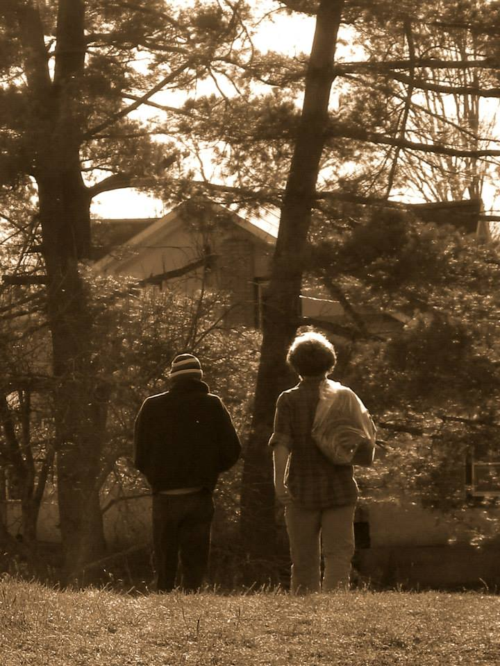 two men walking away from the camera at Wiseacres Farm